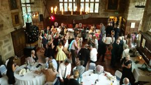 guests joining the happy couple on the dance floor